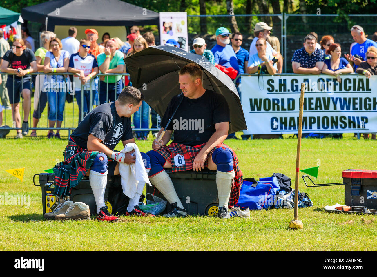 Two competitors in the Scottish Highland Games official World heavyweight Championship, Loch Lomond Highland Games, - Stock Image