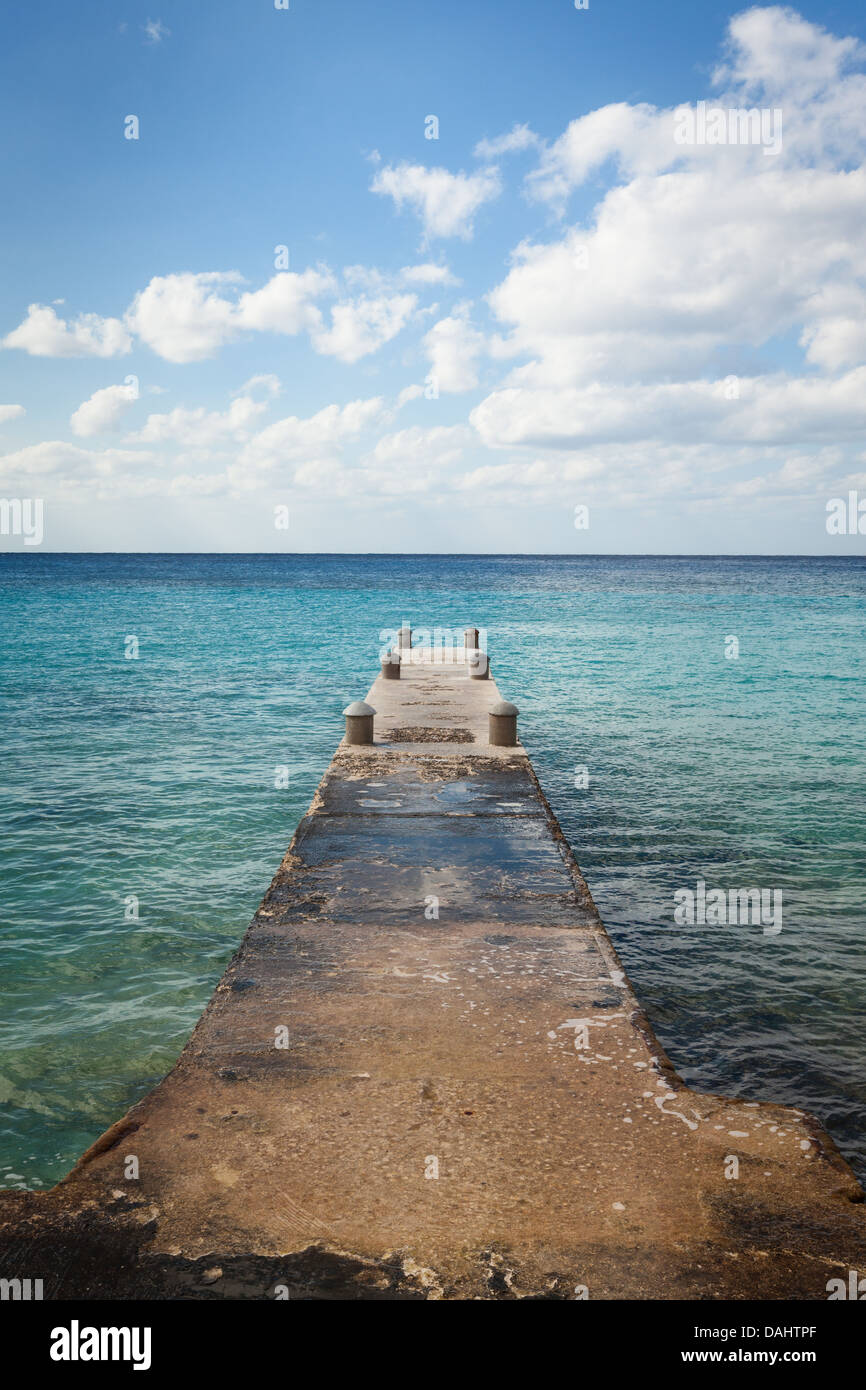 A stone dock overlooking the ocean in Playa Azul Cozumel, Mexico - Stock Image