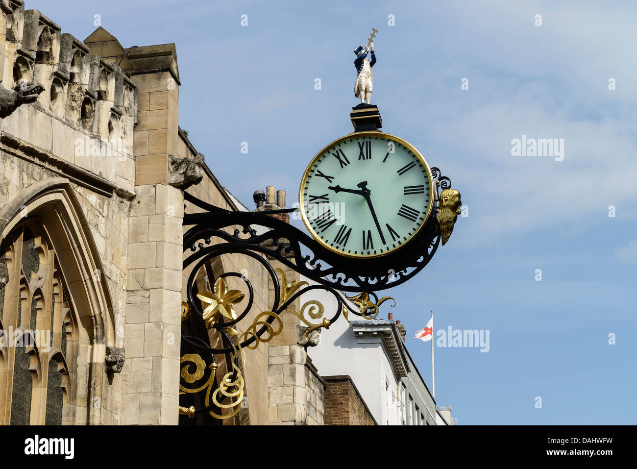The large clock attached to St Martin le Grand church on Coney Street in York city centre UK - Stock Image