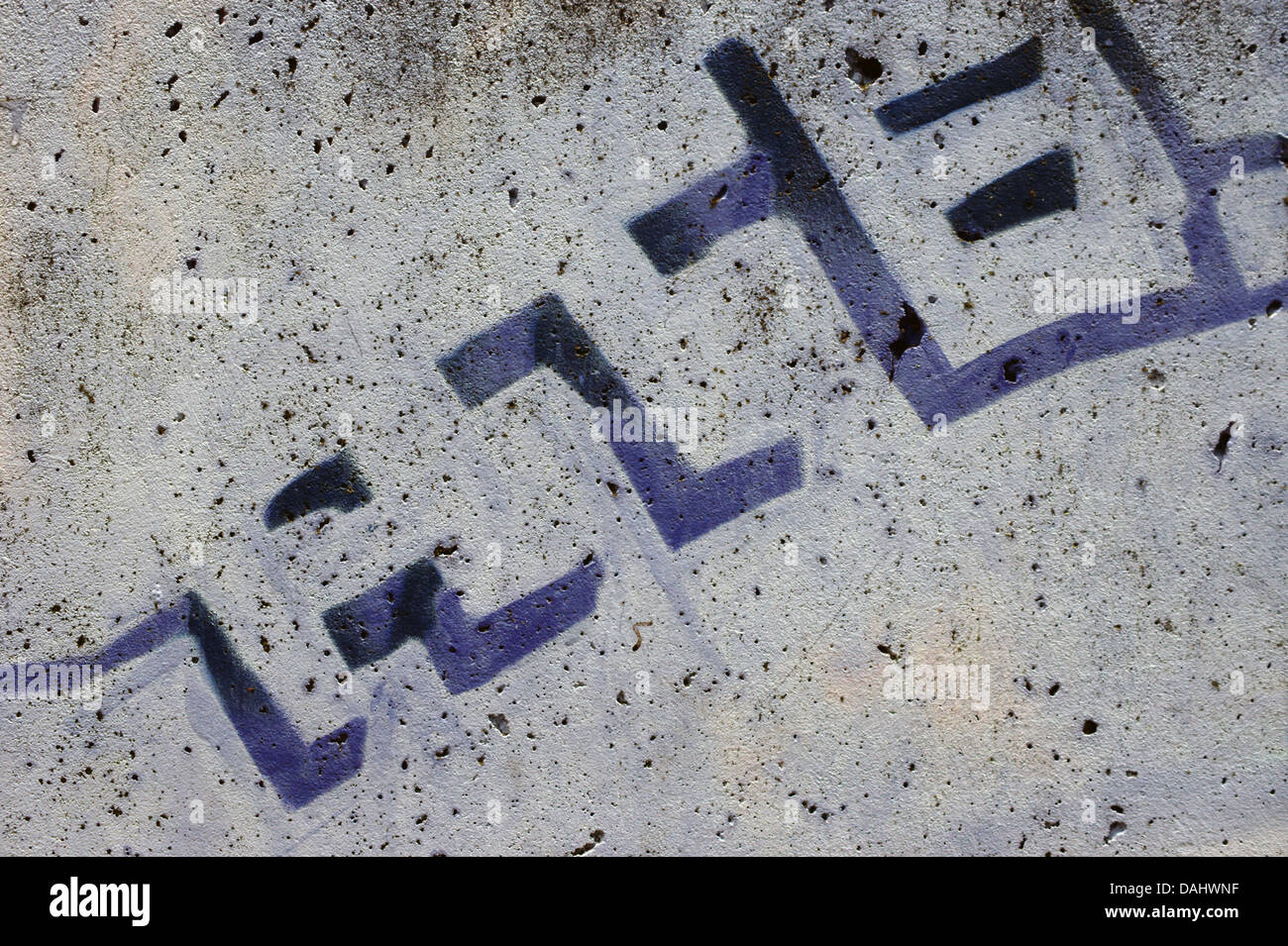 Letters on a porous wall Stock Photo
