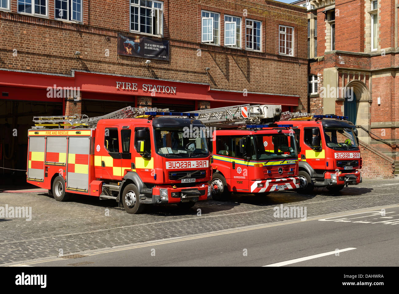 Three fire appliances parked outside York Fire Station - Stock Image