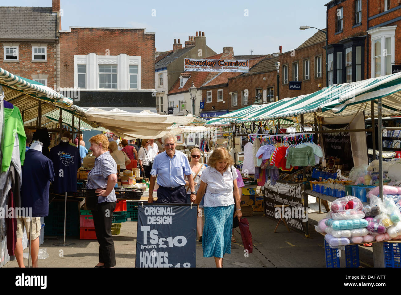Shoppers browse the market stalls in Beverley town centre UK - Stock Image