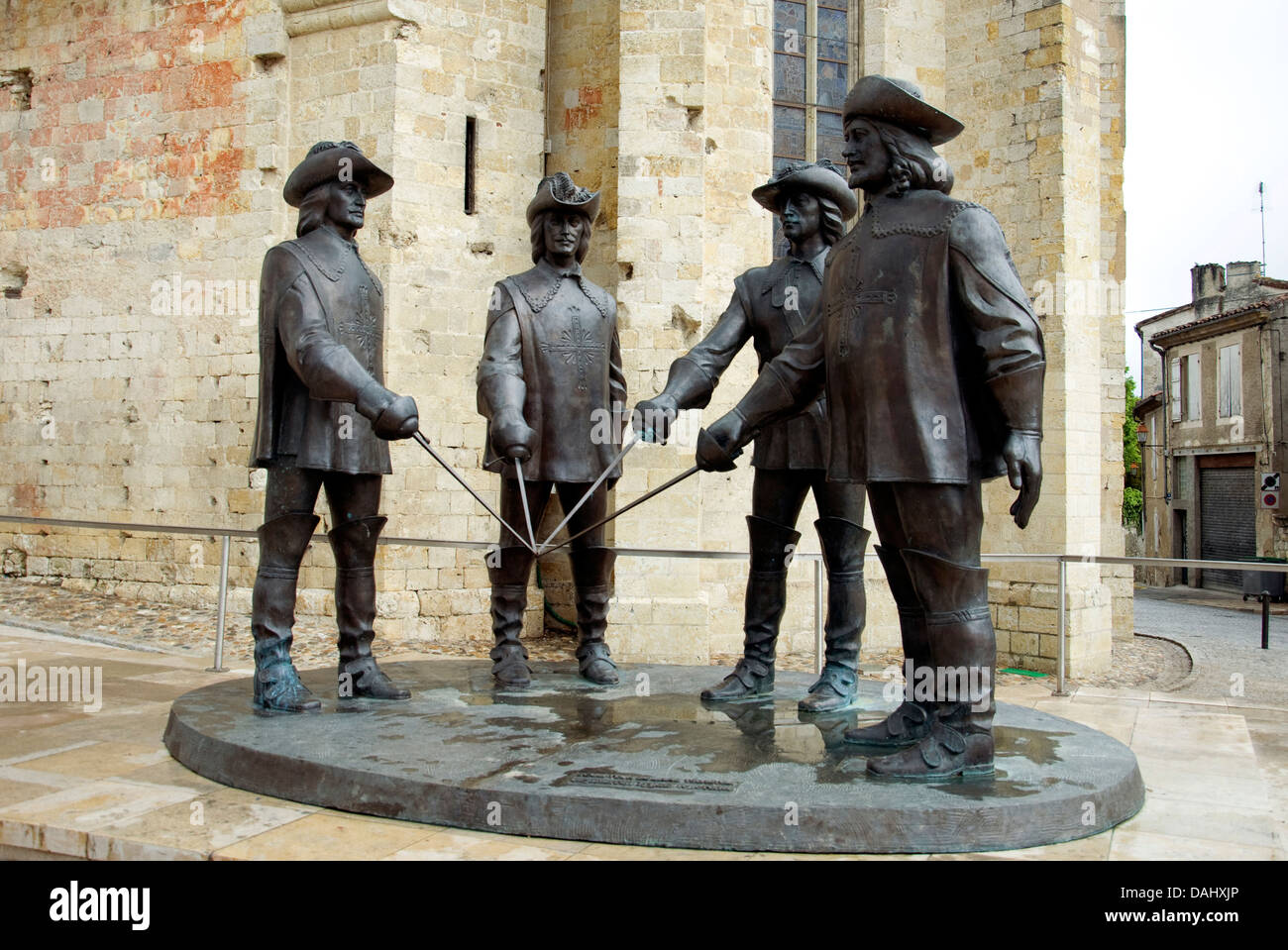 D'Artagnan and the three Musketeers, outside the St Pierre cathedral in Condom on a quiet morning - Stock Image