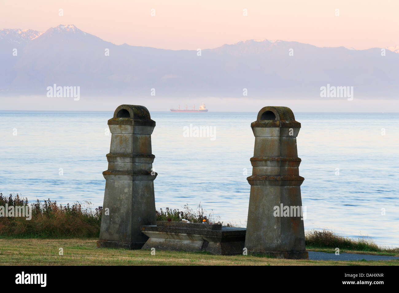 Tombstones in Chinese Cemetery and Bailey Range of Olympic mountains in background at dawn-Victoria, British Columbia, - Stock Image