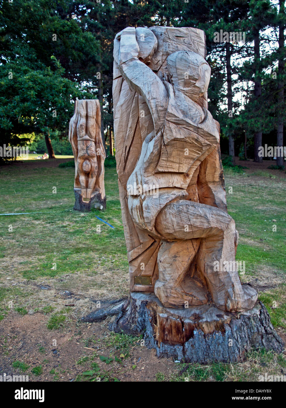 Wooden carving in tree stump stock photos