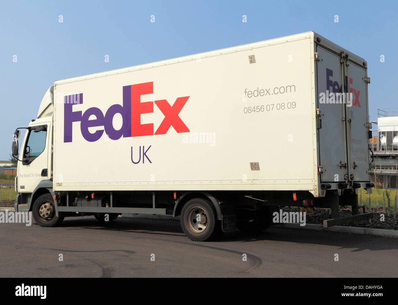 Fed Ex transport transporter truck lorry vehicle England UK FedEx sign logo - Stock Image