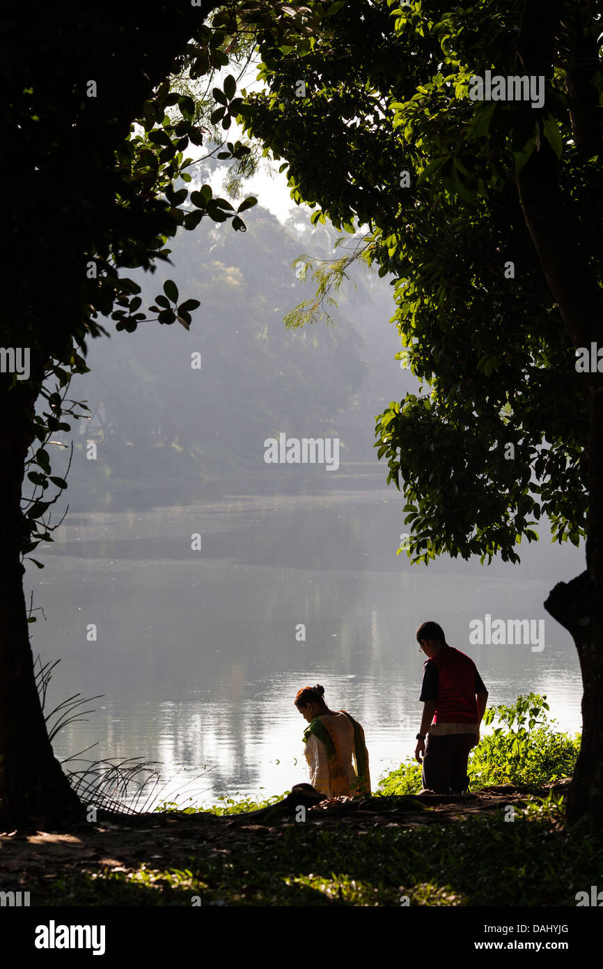 A father and son spend time in the early morning in one Dhakas public parks in the historic old city of Dhaka Bangladesh - Stock Image