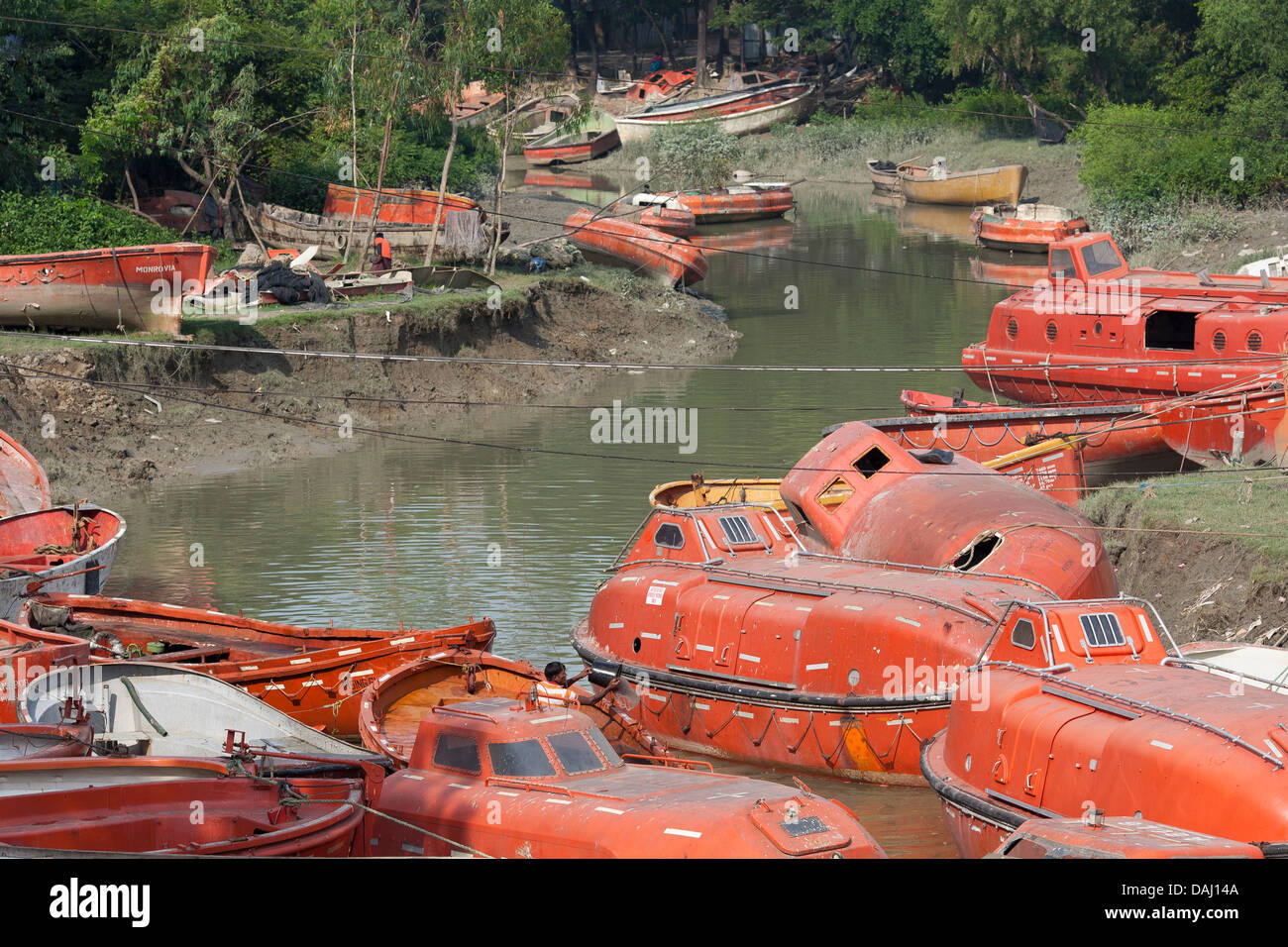 Old discarded bright orange life boats from ships for sale for Sips for sale