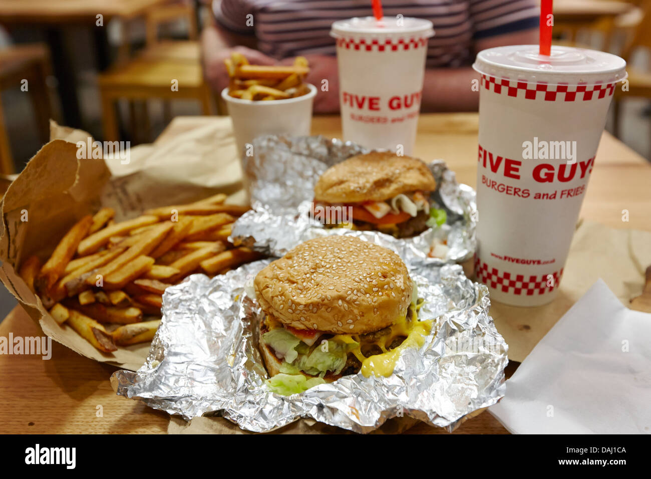 burger and fries and milkshake from five guys burger restaurant newly opened in covent garden london, england uk - Stock Image