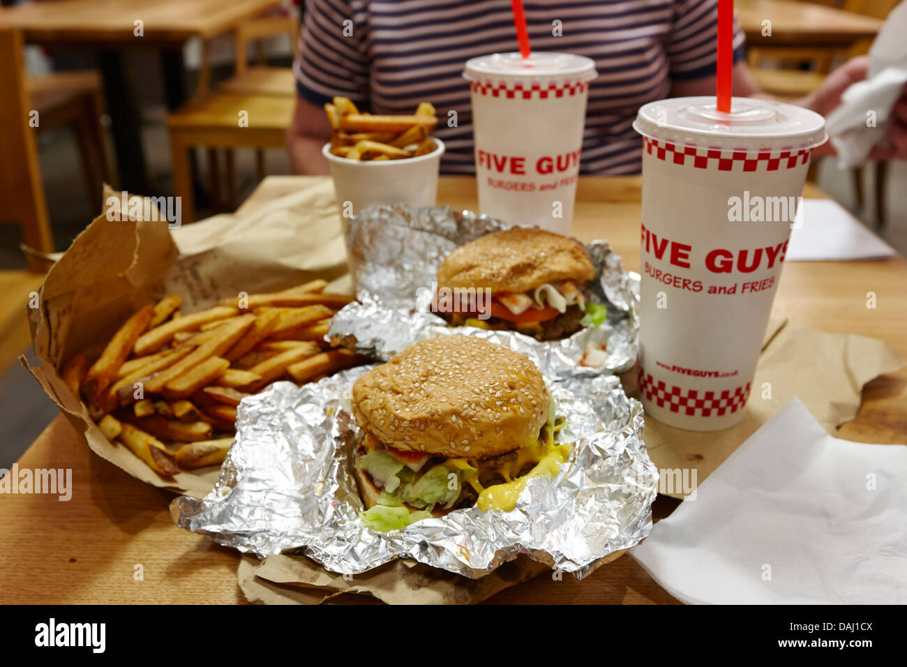 burger and fries from five guys burger restaurant newly opened in covent garden london, england uk - Stock Image