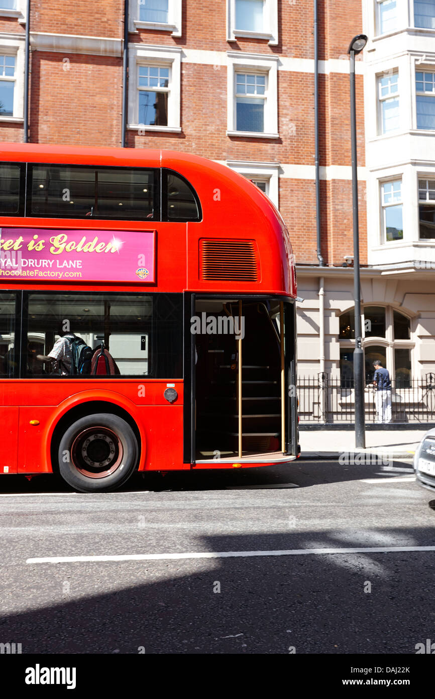 rear hop on hop off area of new london routemaster bus in central london, england uk - Stock Image