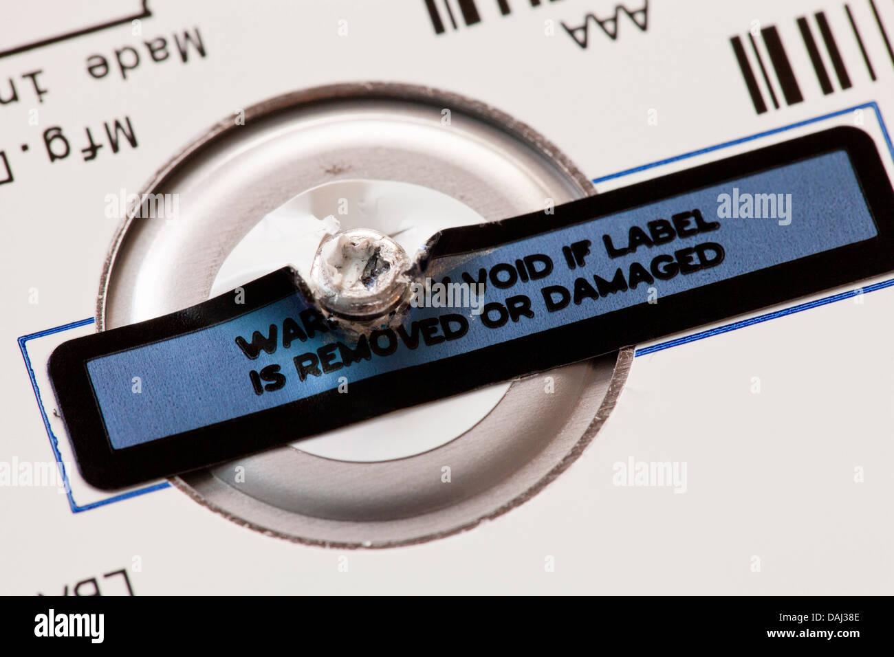 Damaged warranty void label - Stock Image