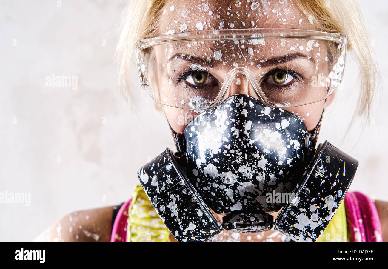 Woman in respirator - Stock Image
