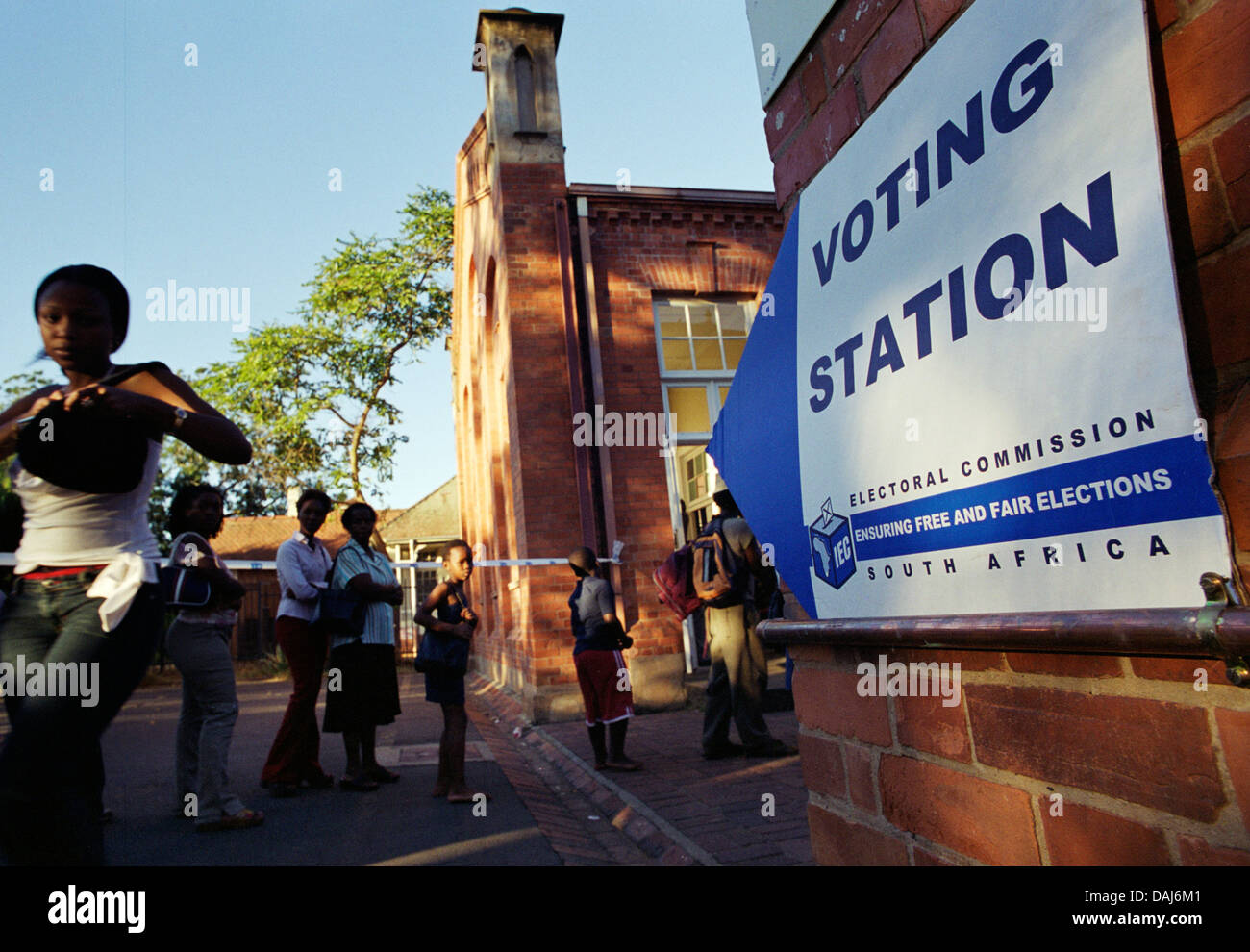 Ten years after South Africa's first democratic elections voters queue again outside polling stations - this - Stock Image