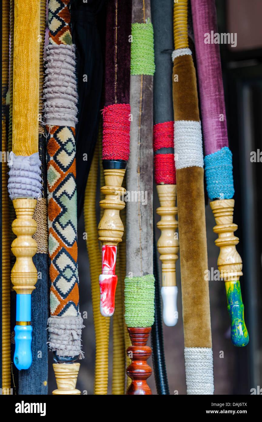 shisha colorful Turkish nargile pipes hanging at the cafe - Stock Image