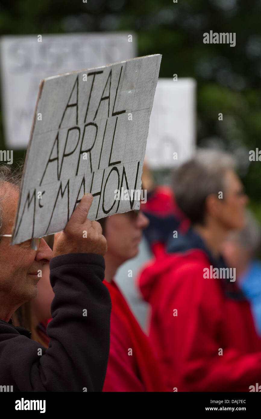During a demonstration in support of suspended staff at Aberyswyth Arts Centre a man holds up a placard. - Stock Image