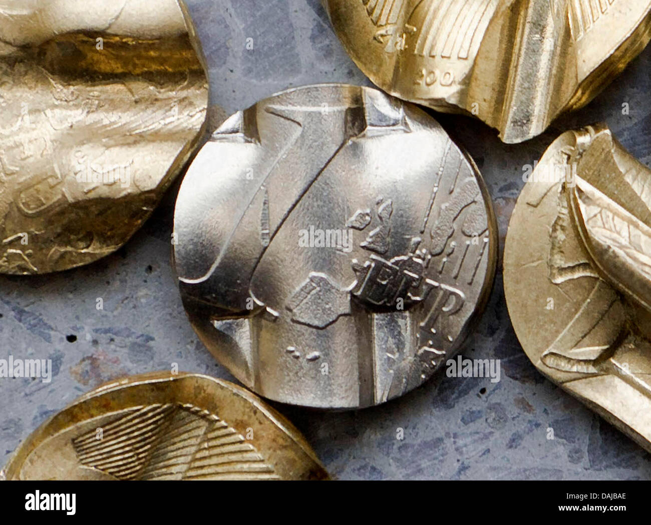 Shredded centers of euro coins lie on a window cill in Hamburg, Germany, 31 March 2011. By both sperating - Stock Image