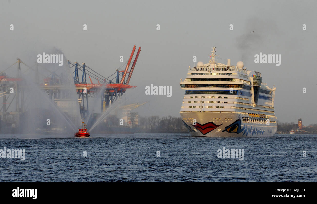 The new cruise ship 'AIDAsol' is pictured next to cranes of the Burchard-wharf in Hamburg, Germany, 01 April - Stock Image