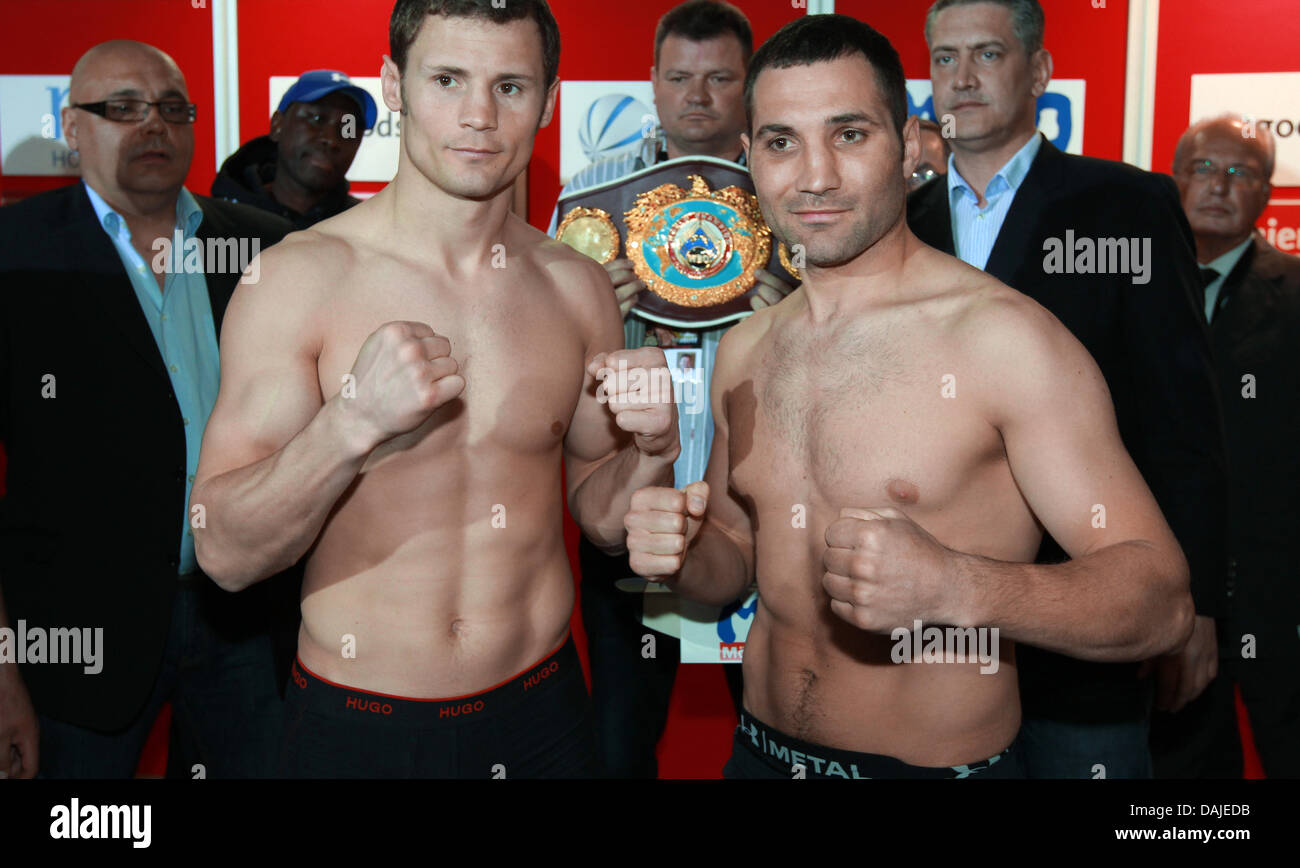 Super middleweight WBO world champion Robert Stieglitz (L) and his challenger Khoren Gevor from Armenia raise their - Stock Image