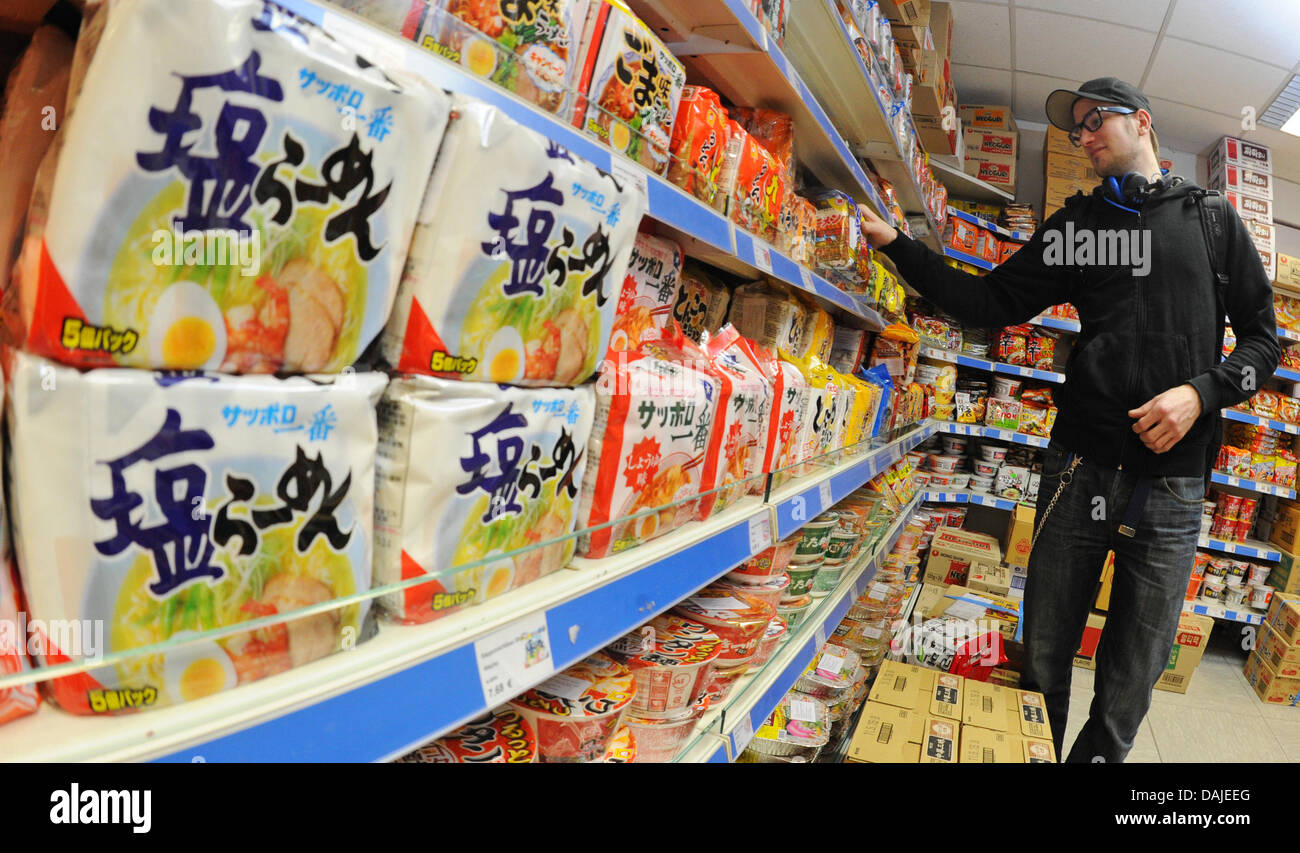 Customer David Mebus buys noodles in a Japanese-Korean food store in Duesseldorf, Germany, 22 March 2011. Consumers' - Stock Image