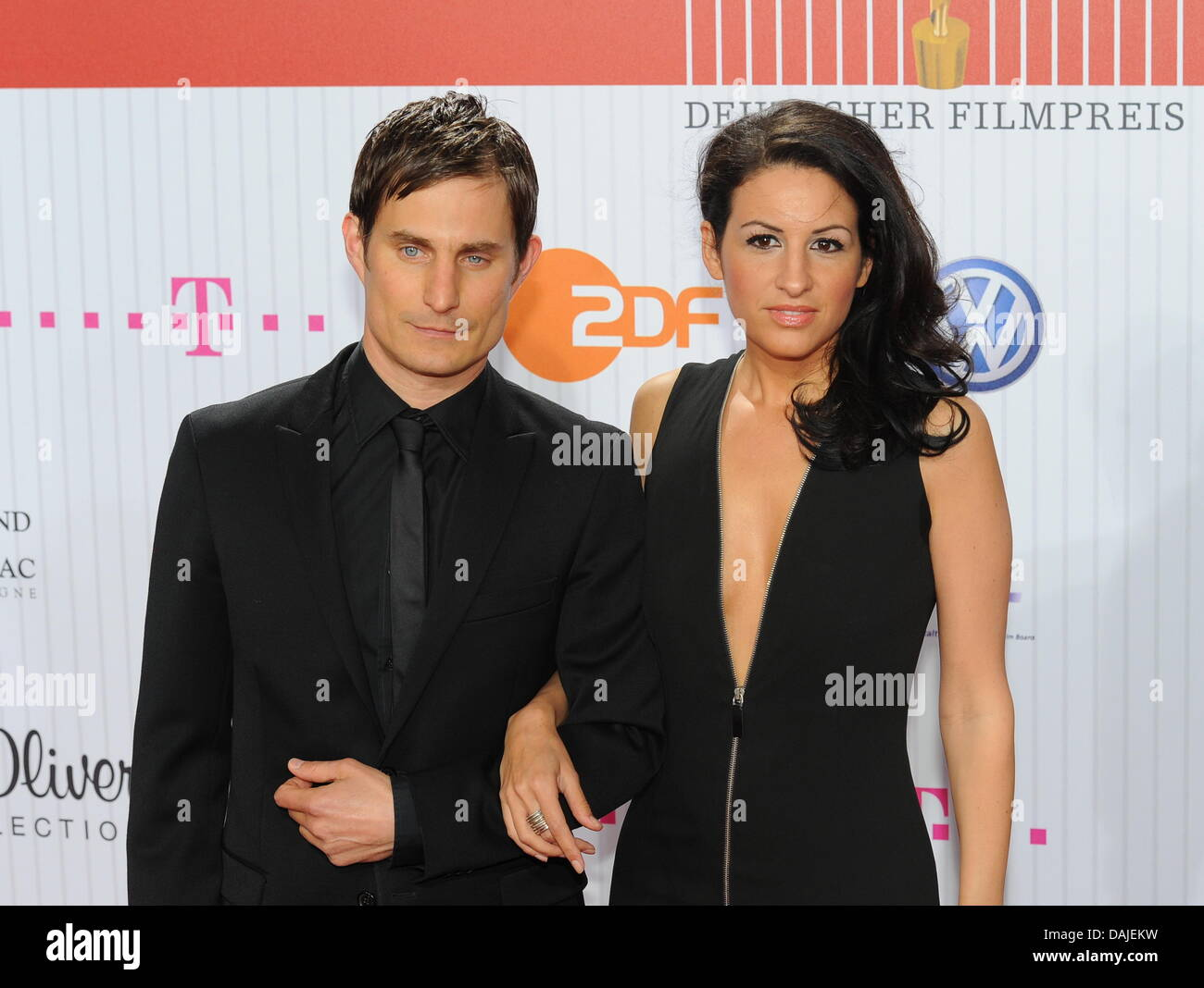 German actor Clemens Schick (L) and German producer Minu Barati-Fischer arrive for the award ceremony of the German - Stock Image