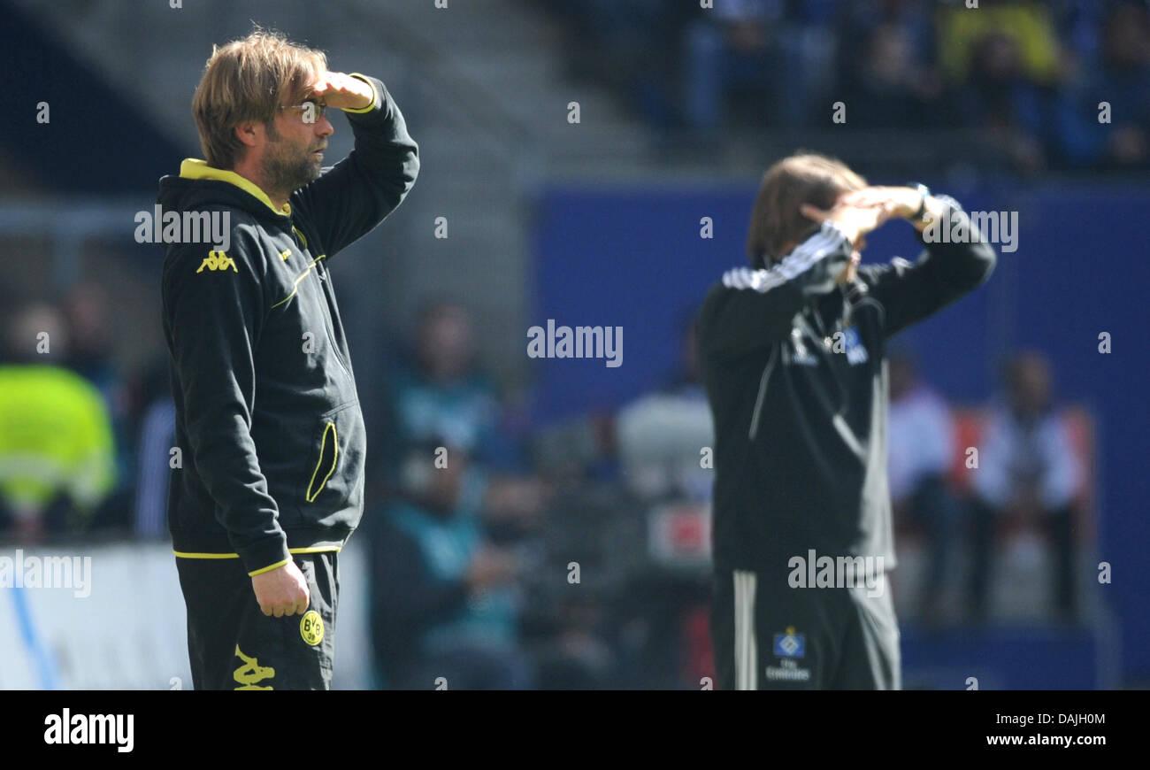 Hamburg's head coach Michael Oenning (R) and Dortmund's head coach Juergen Klopp stand on the sidelines - Stock Image
