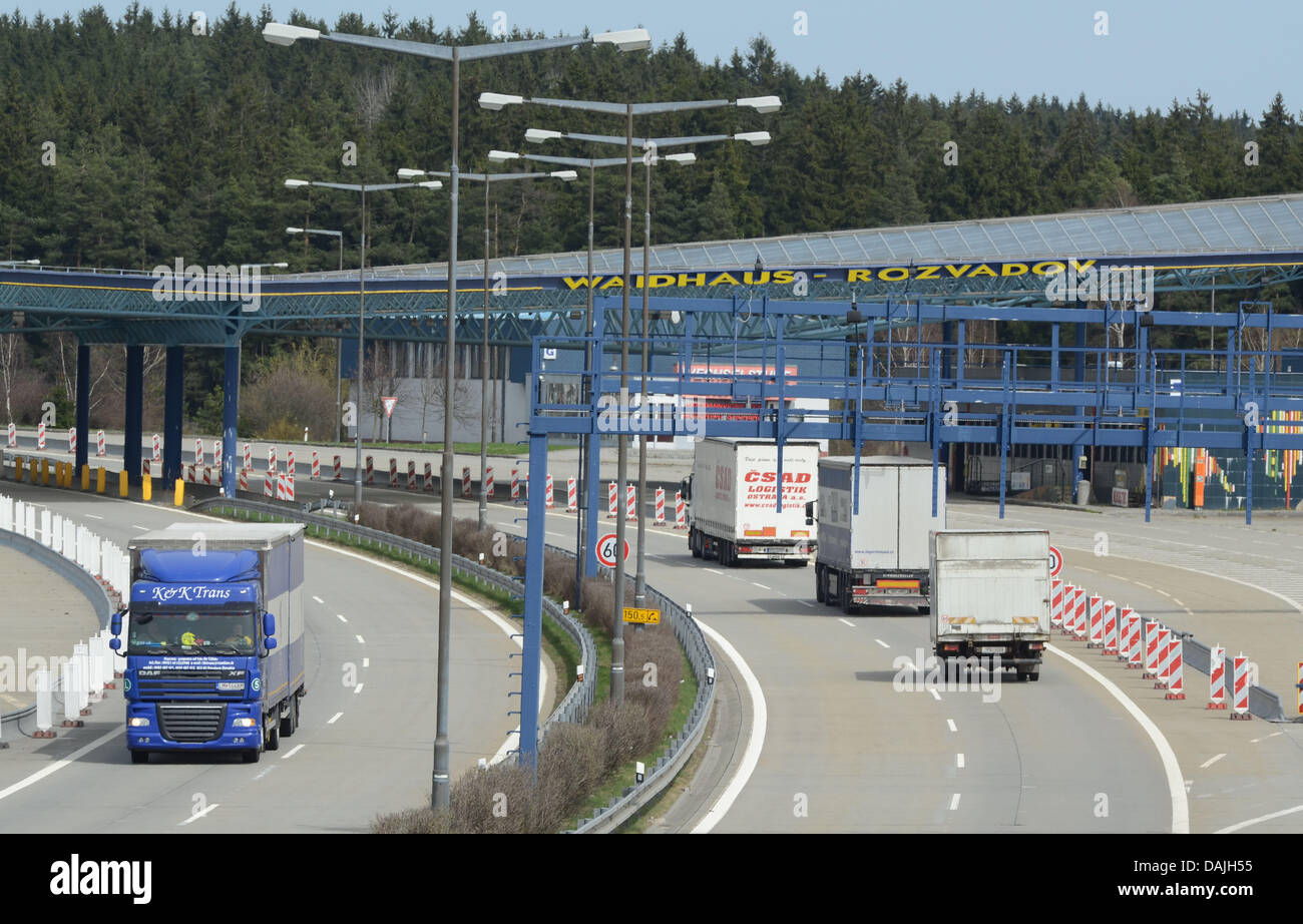 Lorries travel along the Autobahn A6 before the German-Czech border crossing in Waidhaus,Germany, 11 April - Stock Image