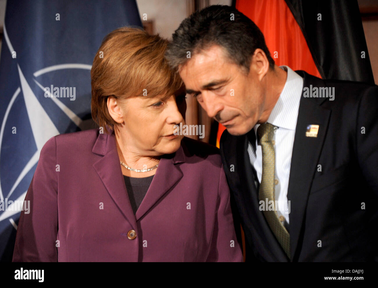 NATO General Secretary Anders Fogh Rasmussen (r) talks with German Chancellor Angela Merkel during a reception at Stock Photo