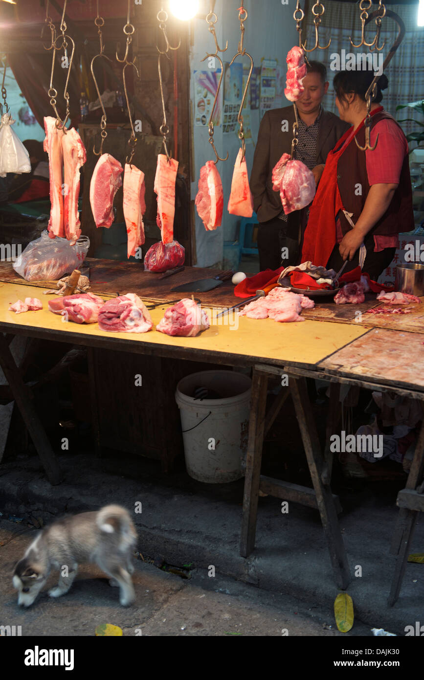 A small butcher at an old community to be developed in Chongqing, China. 9-May-2013 - Stock Image