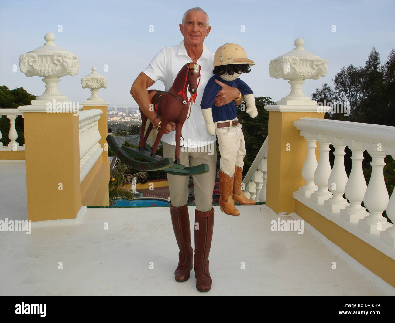 Frederic Prince Of Anhalt Poses Next To A Wooden Doll And A Horse On His  Terrace In Bel Air, Los Angeles, USA, Undated Handout. The 67 Year Old  Bought The ...