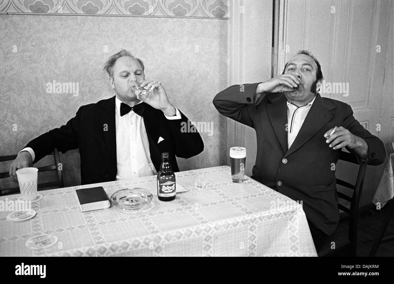 A file picture shows two men alcoholic drinks during the corpus christi celebration in Helbra, Germany, 14 June - Stock Image