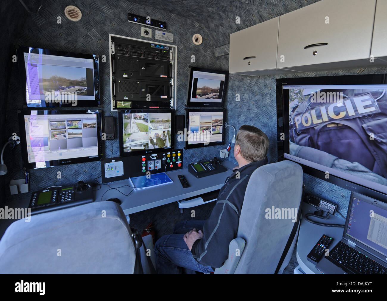 A Czech Police Officer Sits In A Mobile Video Surveillance Police
