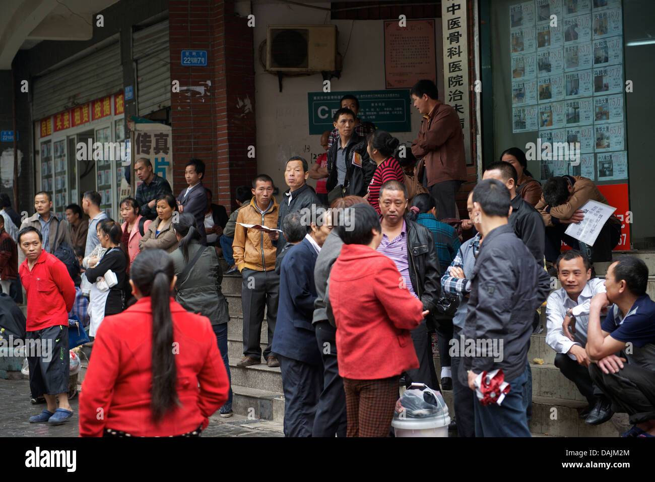 People wait job opportunities in a labor market in Chongqing, China. 09-May-2013 - Stock Image