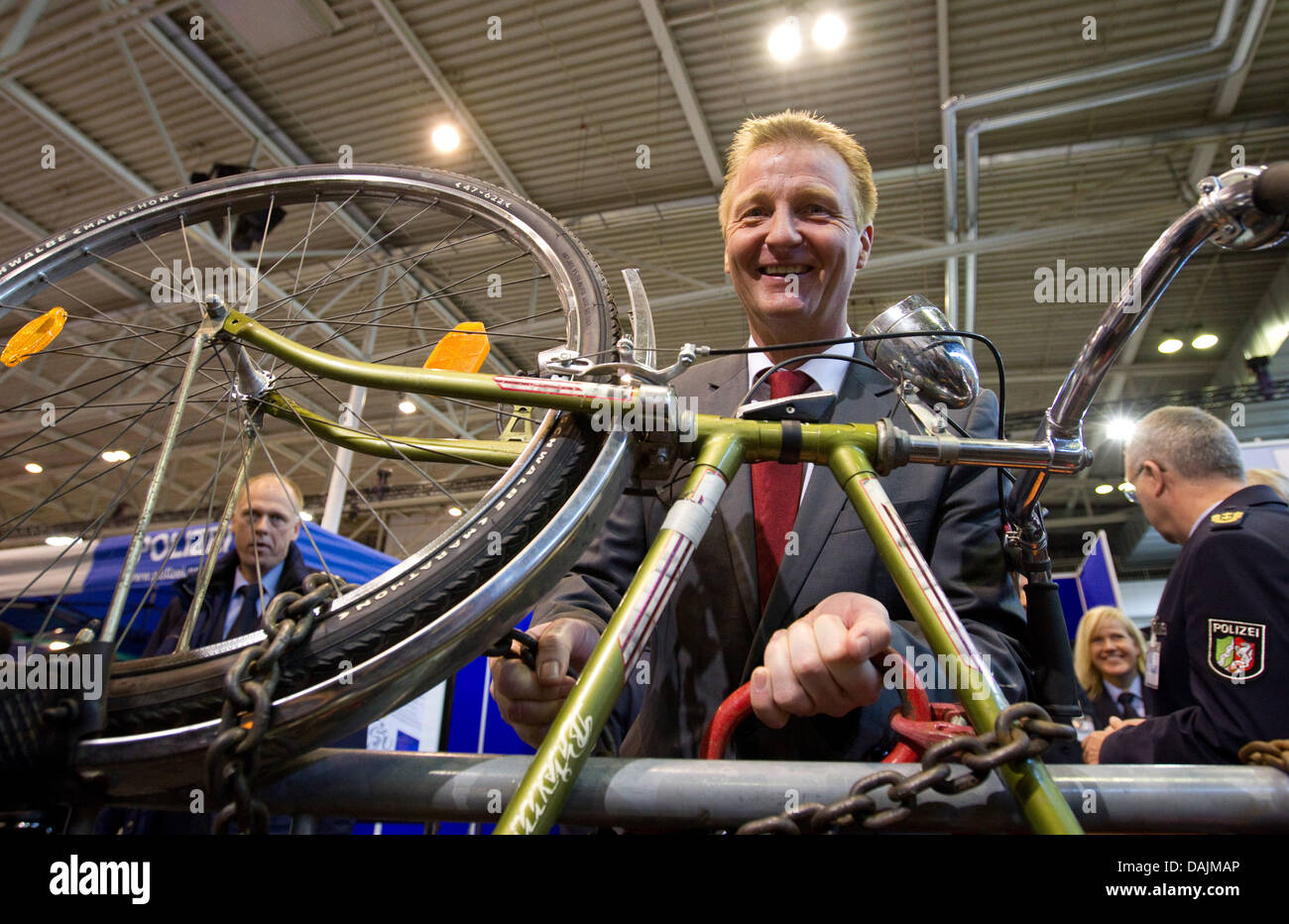 North Rhine-Westphalia's Interior Minister Ralf Jaeger poses with a locked bike at the police trade show Ipomex Stock Photo
