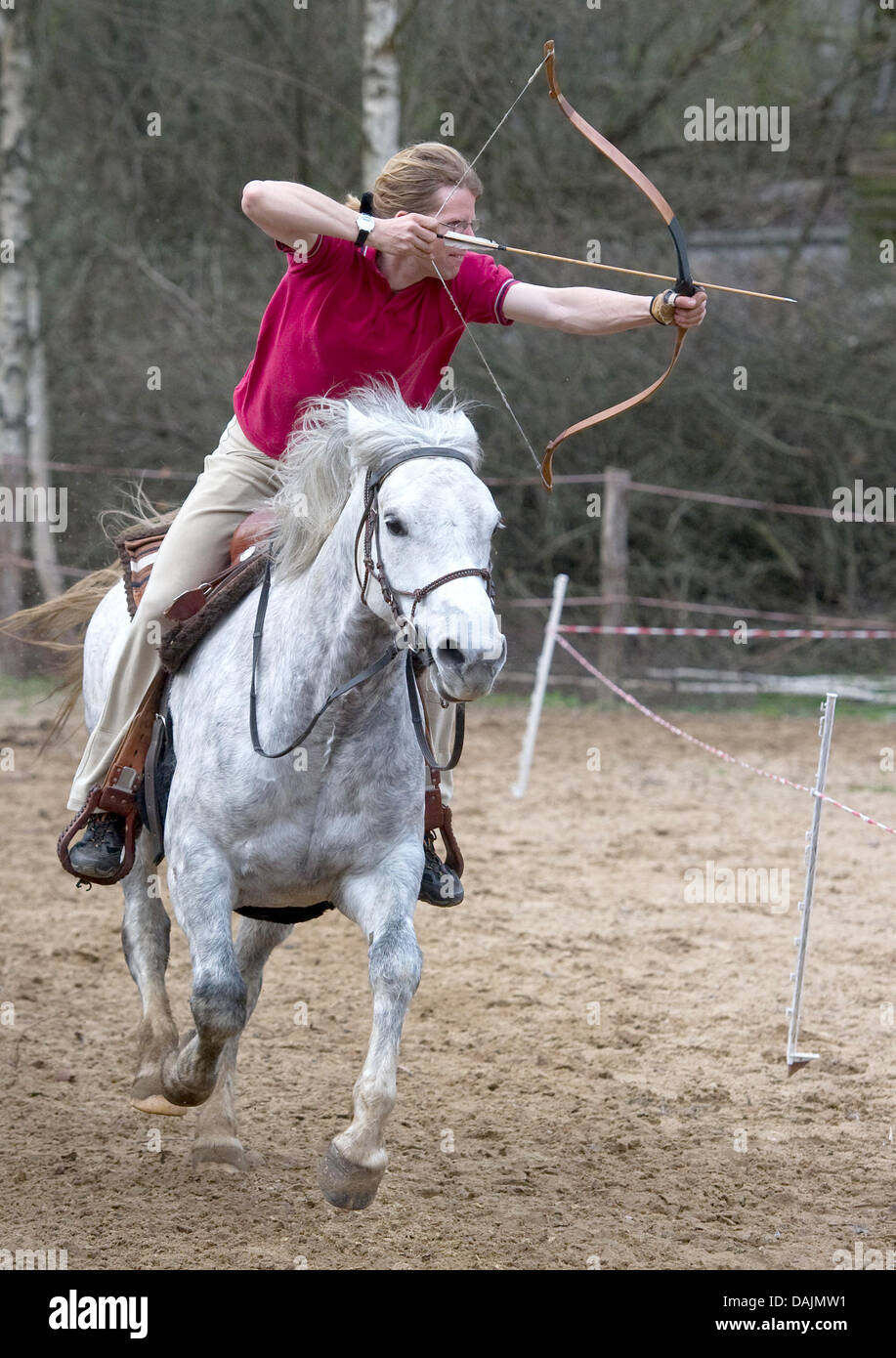 At the Sunbow Ranch, Christian Scholle-Prestin trains the archery on horseback in  Muencheberg, Germany, 11 April - Stock Image