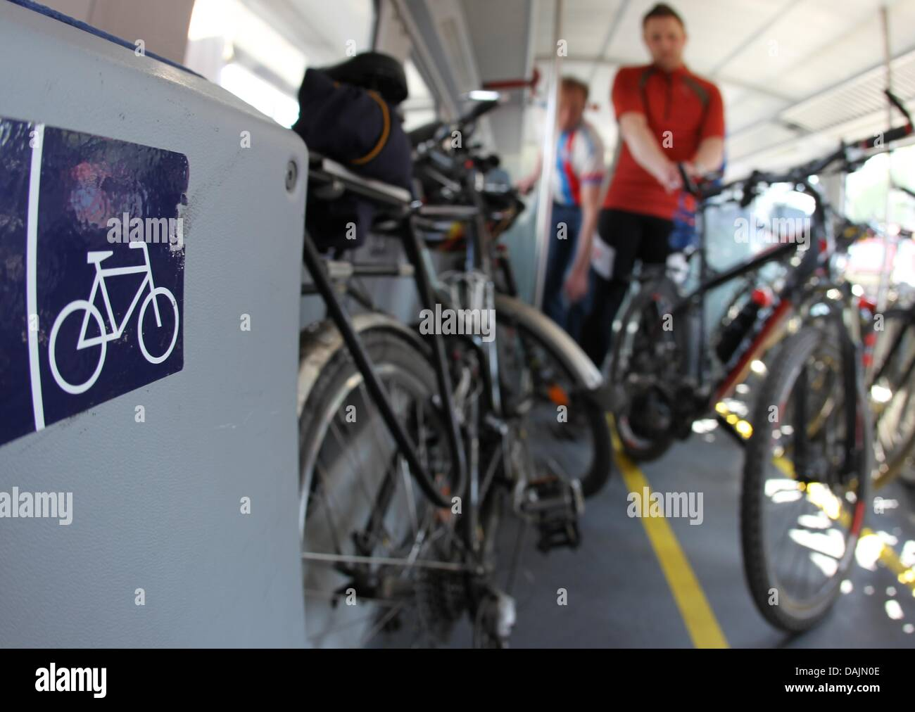 Members of the German Bicycle Club (ADFC) place their bikes in a train at the main station of Nuremberg, Germany, - Stock Image
