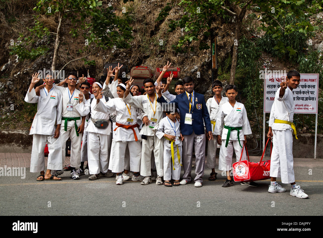Martial Art players waving hands at roadside, Mall Road, Mussoorie, Uttarakhand, India - Stock Image