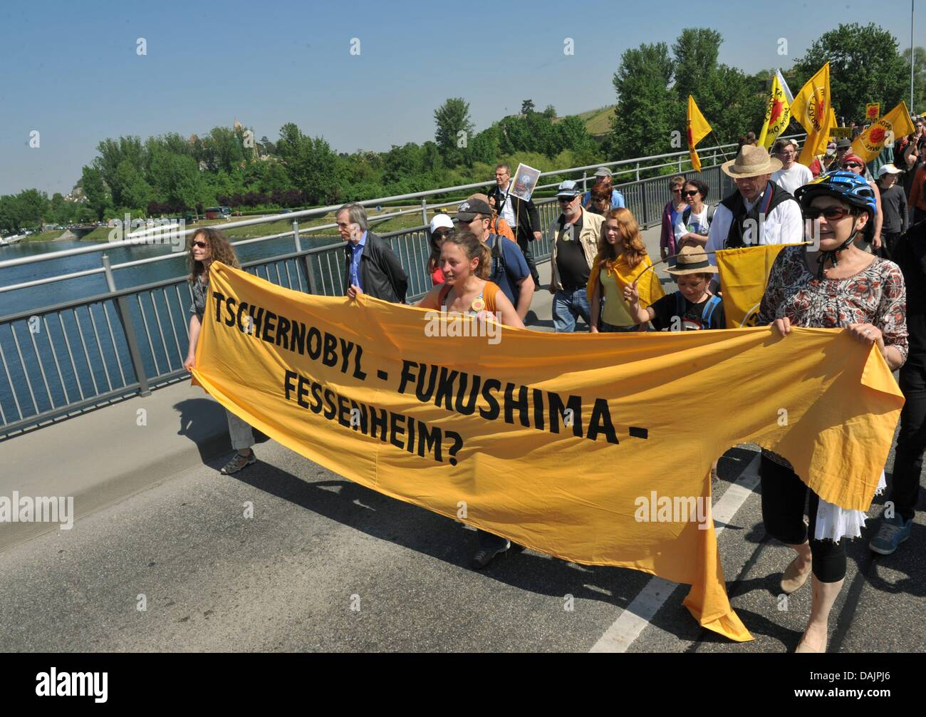 French and German anti-nuclear activists stage a protest on the rhine bridge between Alsatian Neuf-Brisach and Breisach, - Stock Image