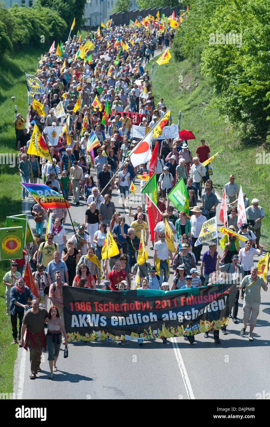 Anti-nuclear activists participate in a protest march leading to the nuclear power plant in Neckarwestheim, Germany, - Stock Image