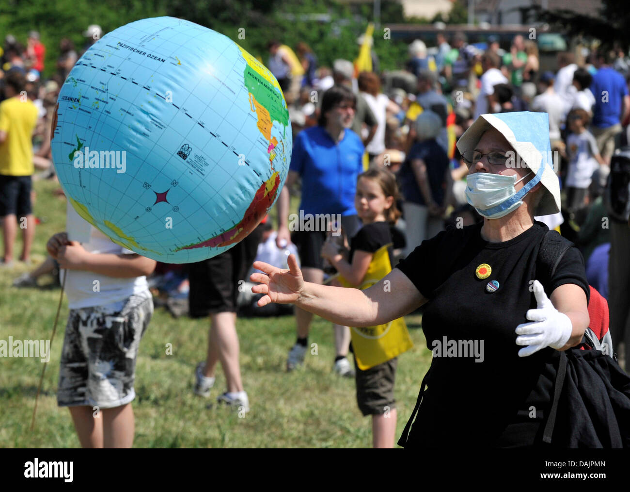 An anti-nuclear activist holds a rubber globe during an easter protest march against nuclear power plants in Biblis, - Stock Image