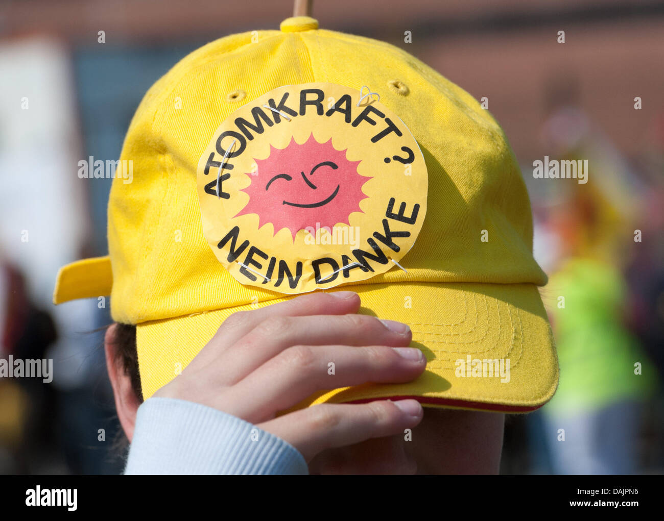 Anti-nuclear activists wear the anti-nuclear logo during a protest at the nuclear power plant nearby the city of - Stock Image