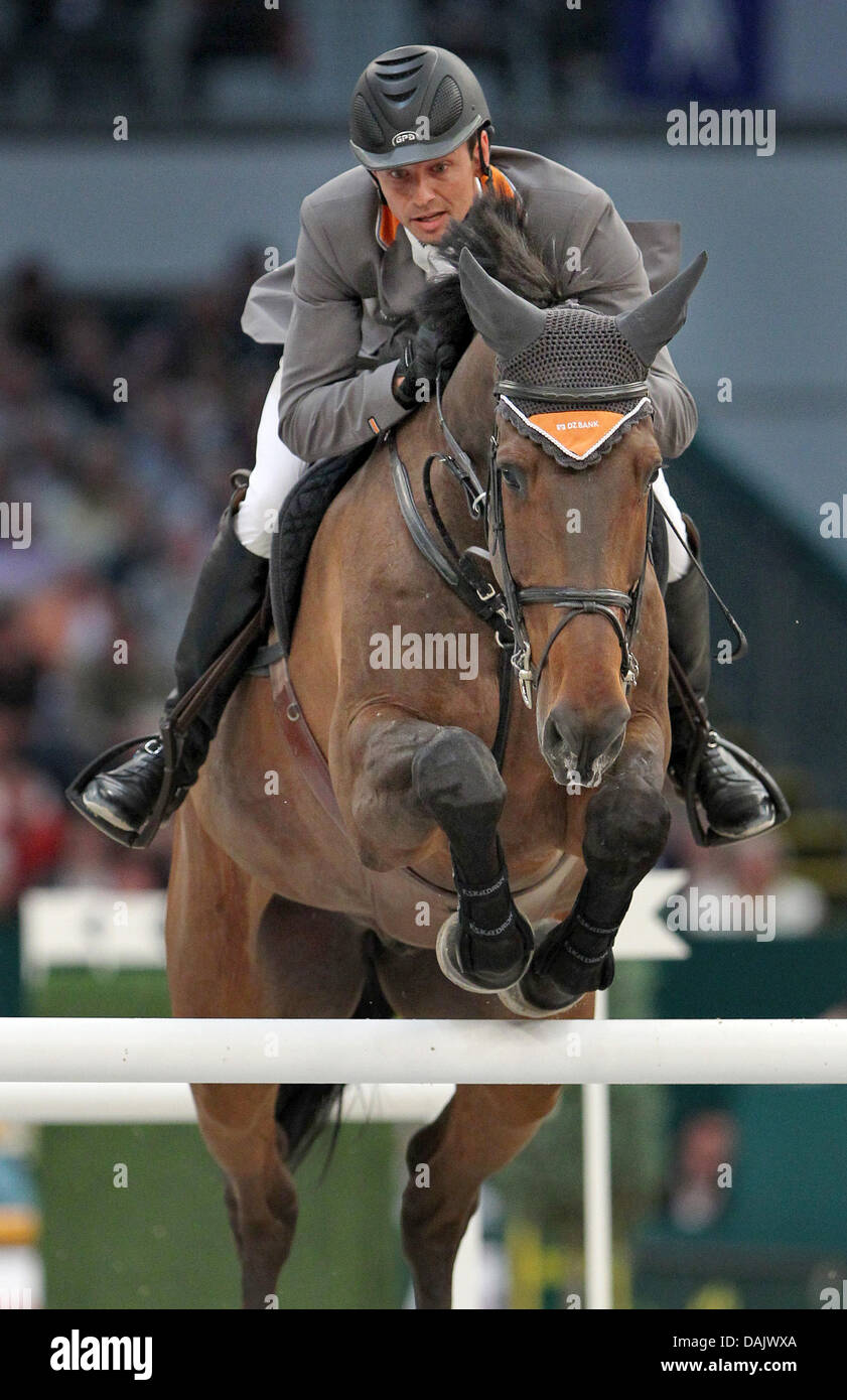 German rider Marco Kutscher jumps on Cash at the FEI World Cup jumping Final  in Leipzig, Germany, 1 May 2011. Photo: Stock Photo