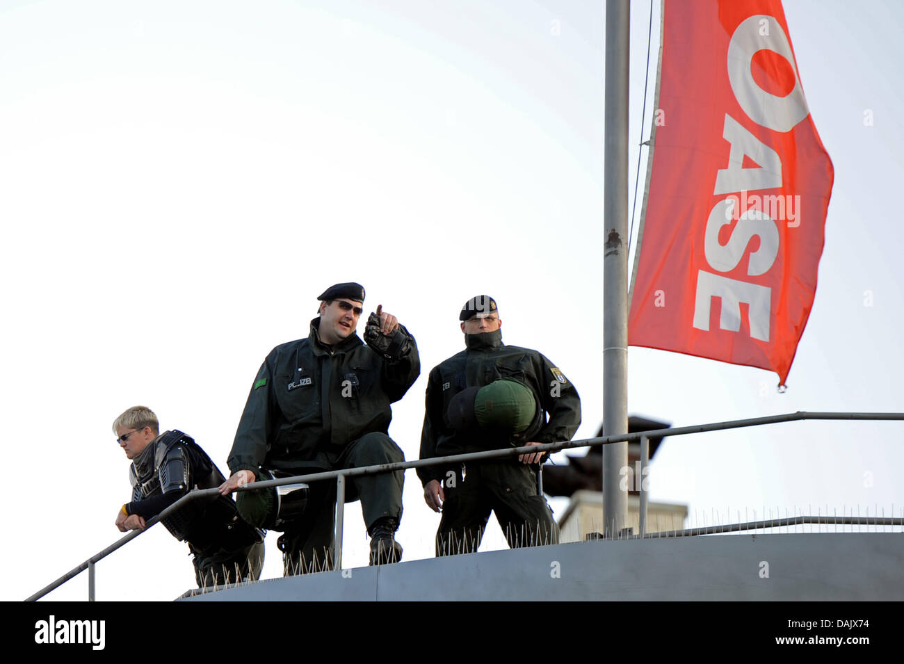 Police officers stand at the roof of an office building at the revolutionary May Day demonstration in Berlin, Germany, - Stock Image