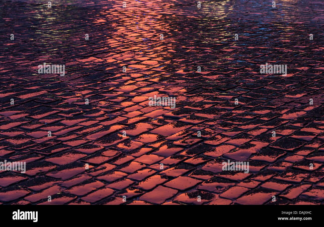 Reflecting wet cobblestones - Stock Image