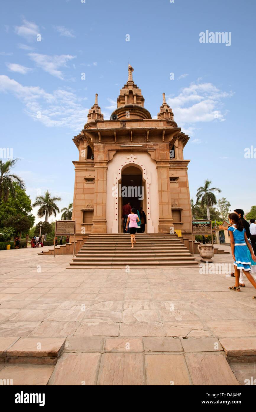 Tourists at a temple, Mulagandha Kuti Vihar temple, Sarnath, Varanasi, Uttar Pradesh, India - Stock Image