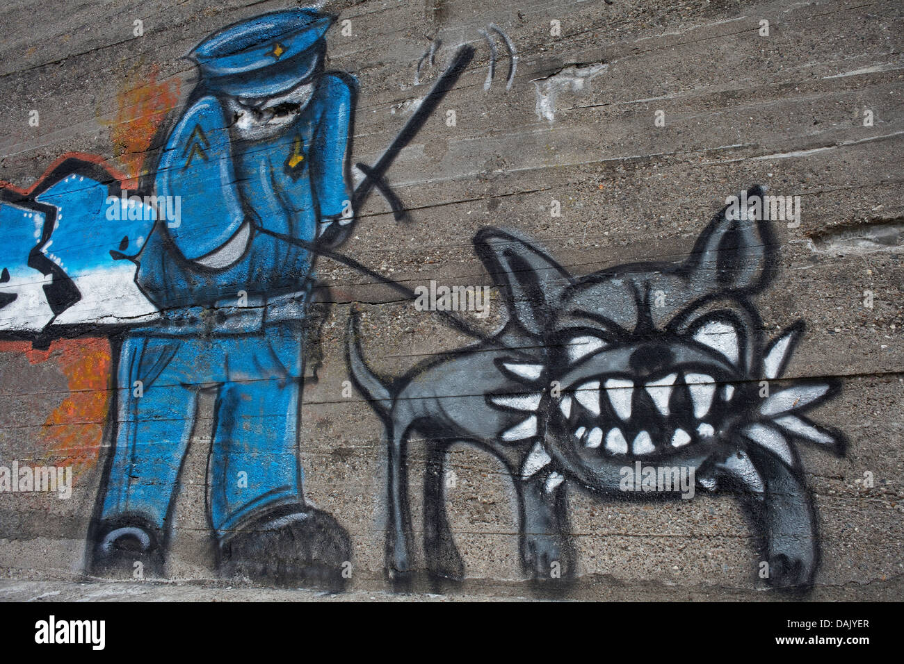 Policeman with a tough dog, graffiti - Stock Image
