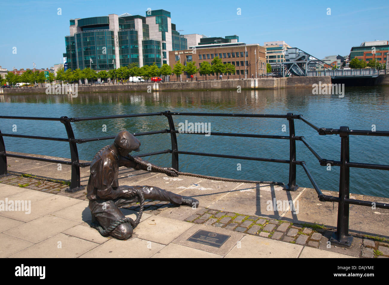 The Linesman statue(2001) by Dony McManus in Docklands former harbour area by River Liffey central Dublin Ireland - Stock Image