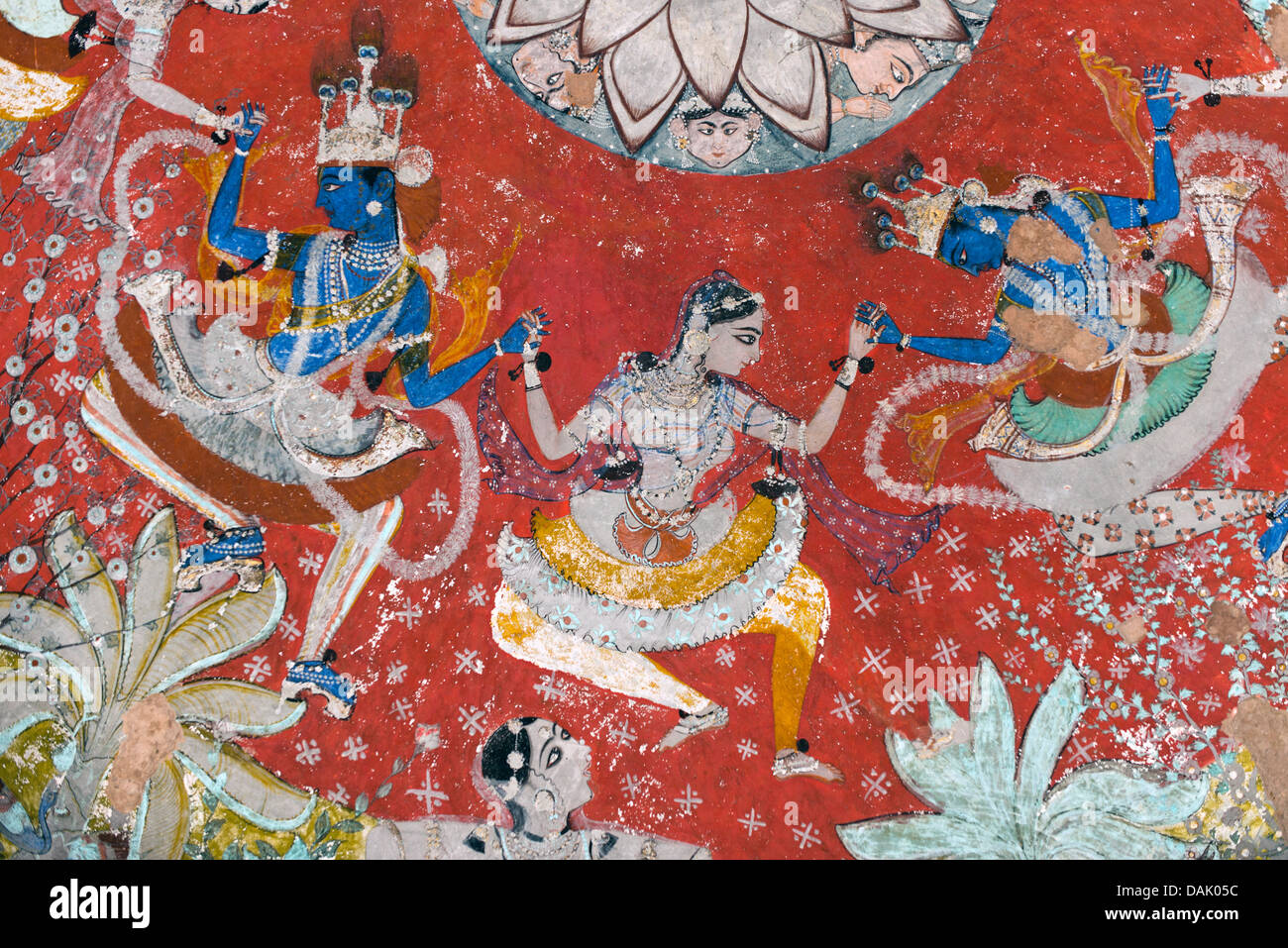 Pastoral god Krishna dancing the Rasa Lila dance with the Gopis, mural or fresco painted with natural colours - Stock Image
