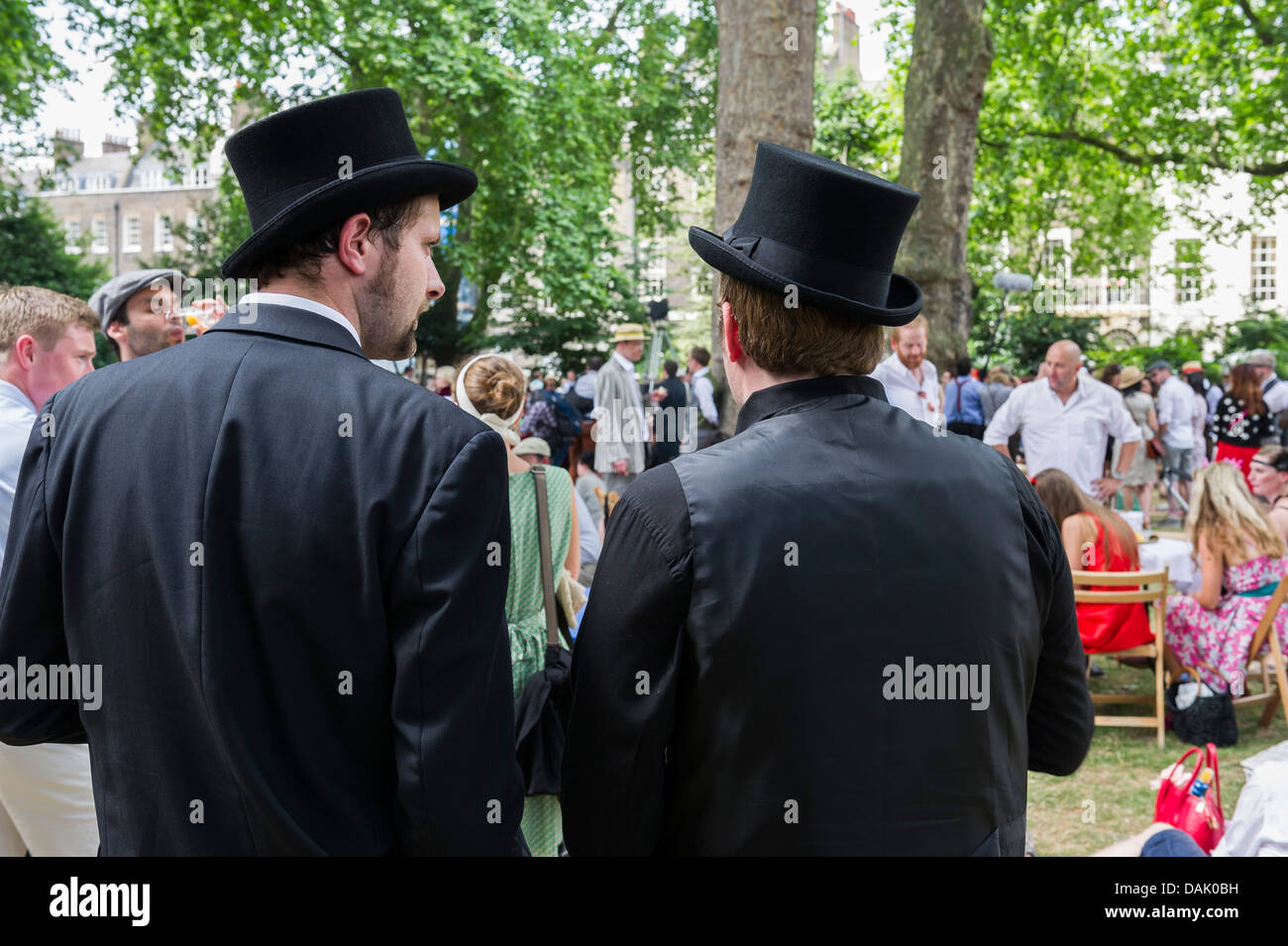 Two chaps wearing top hats at the Chaps Olympiad in Bedford Square Gardens. - Stock Image
