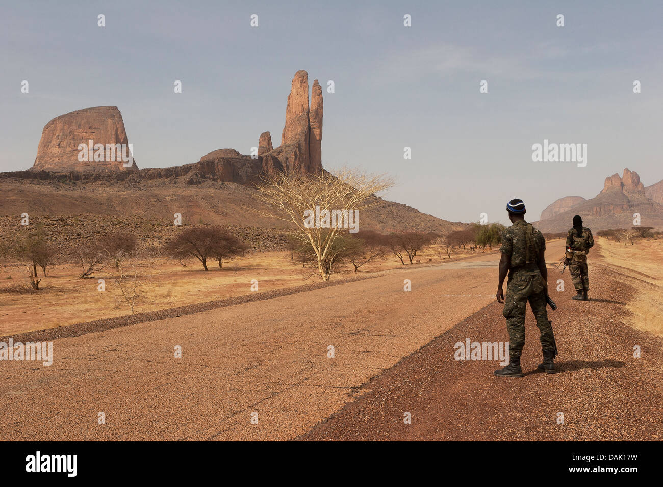 Armed soldiers from Malian army on patrol looking out for members of  al-Qaeda near 'The Hand of Fatima' - Stock Image